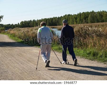 Two elderly men walking, view - stock photo