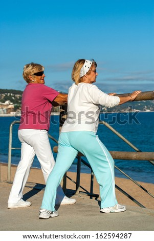 Two elderly women getting ready for jogging outdoors.