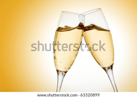 Two elegant champagne glasses high resolution image - stock photo