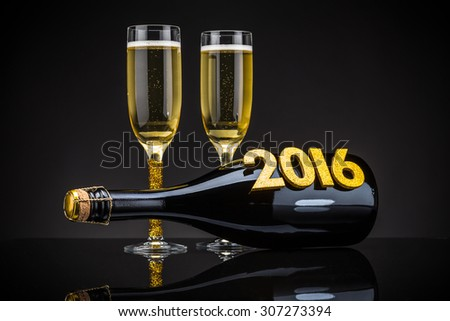 Two elegant champagne glasses with bottle - stock photo