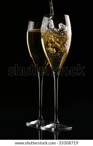two elegant glasses with champagne - stock photo