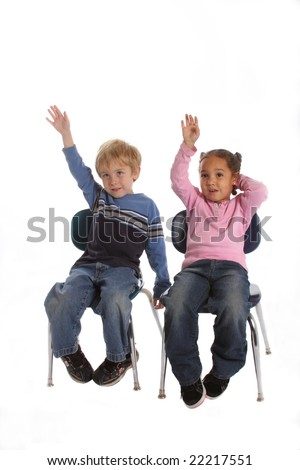 Two elementary school kids raising their hands to answer a question