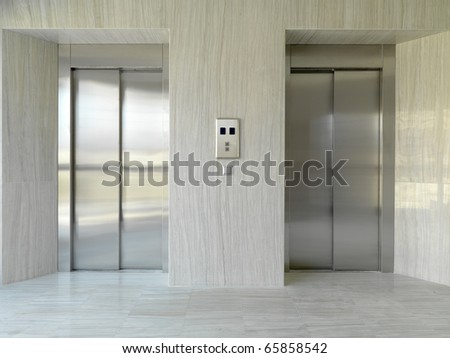 two elevator doors in a luxurious building