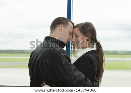 Two embracing people waiting on a plane - stock photo