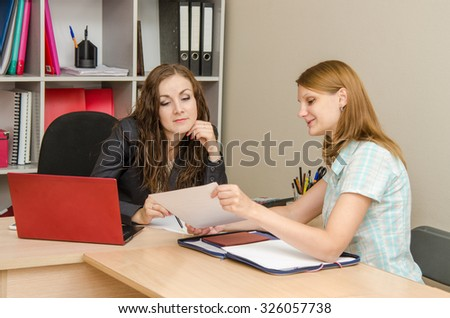 Two employees of office read the document