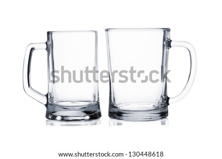 Two empty beer mugs isolated on white background - stock photo