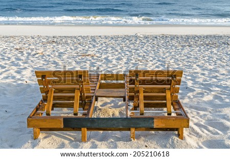 Two empty chairs sitting on the beach on the Alabama Gulf Coast.