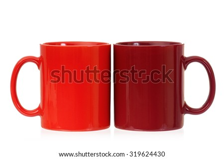 Two empty cups for coffee or tea, isolated on white background - stock photo