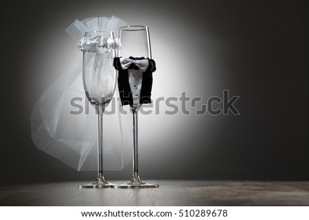 Two empty decorated champagne glasses for wedding party