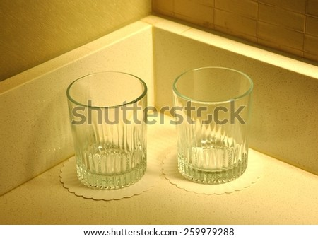 Two empty drinking glasses - stock photo