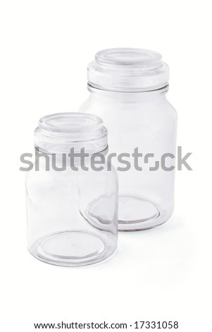 Two empty glass jars side by side on white background