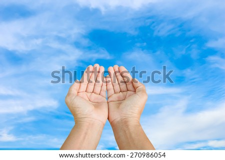 two empty hand on blue sky - stock photo