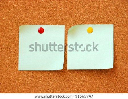 two empty,note,pads,on,cork,board