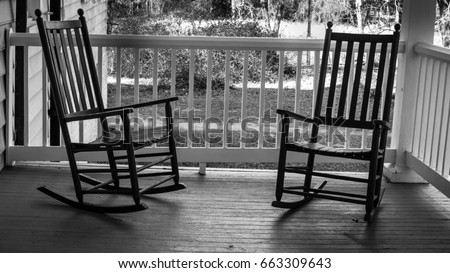Two Empty Rocking Chairs. Two wooden rocking chairs on a front porch on a warm & Two Empty Rocking Chairs Two Wooden Stock Photo (Royalty Free ...