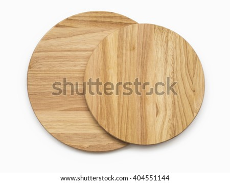 Two empty round cutting boards on white