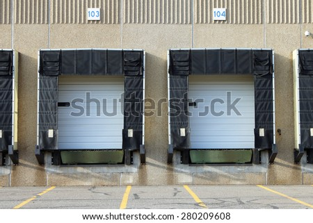 Two empty truck docks await their next load of freight.  - stock photo