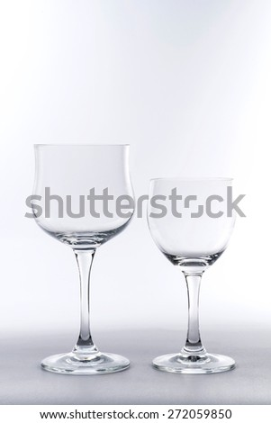 Two Empty Wine Glass on White Background - stock photo