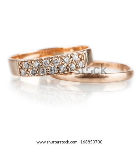 Two engagement gold wedding  rings, isolated on white - stock photo