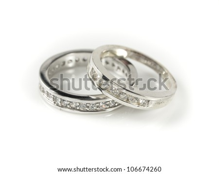 Two engagement rings, isolated on white - stock photo