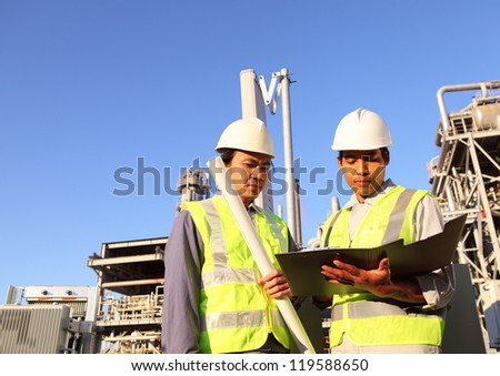 two engineer discussion  on location site - stock photo