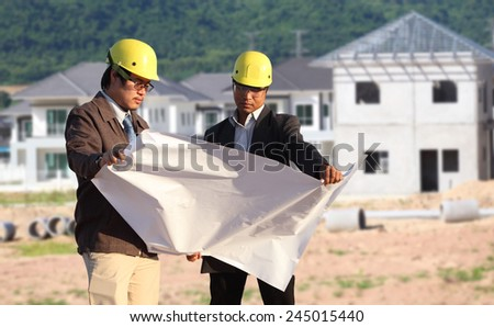 two engineer on site  at new home - stock photo
