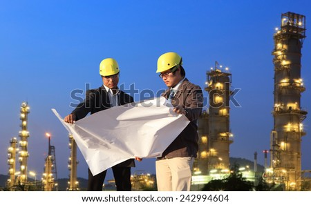 two engineer standing area of refinery oil and gas project  - stock photo
