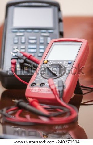Two Engineering Measure Units With  Connected Probes of Red and Black Color for Indication. Vertical Image Composition - stock photo