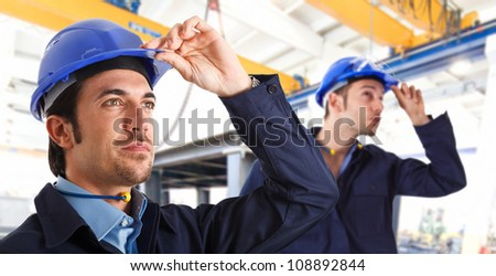 Two engineers at work in a factory - stock photo