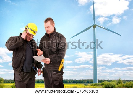 Two Engineers in a Wind Turbine Power Station  - stock photo