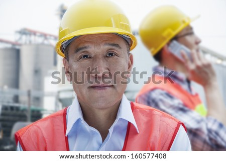 Two engineers in protective workwear working