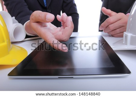 Two Engineers people discussing their project - stock photo