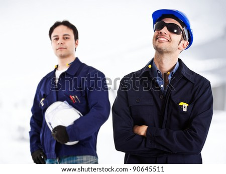 Two engineers working together in a construction site - stock photo