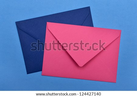two envelopes on a blue background - stock photo