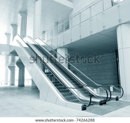 Two escalators in new modern building. - stock photo