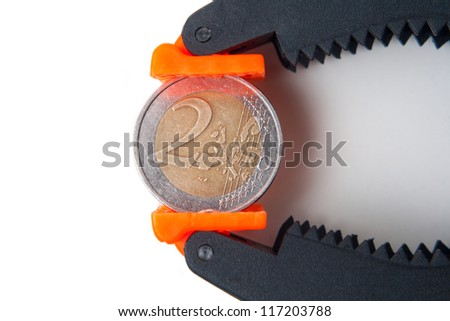 two euro coin under pressure - stock photo
