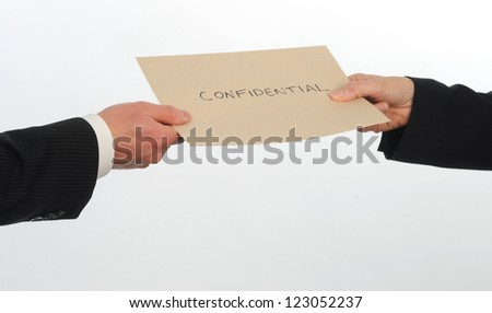 Two executives exchange envelope containing confidential information