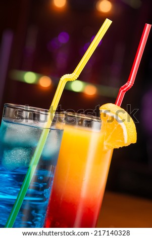 Two exotic cocktails in cafe - stock photo
