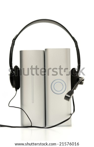 Two external hard drive with headset on white - stock photo