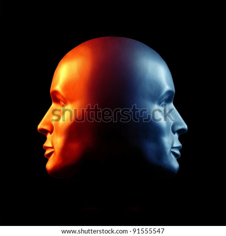 Two-faced head statue suggesting extremes or split personality. Fire & Ice. - stock photo
