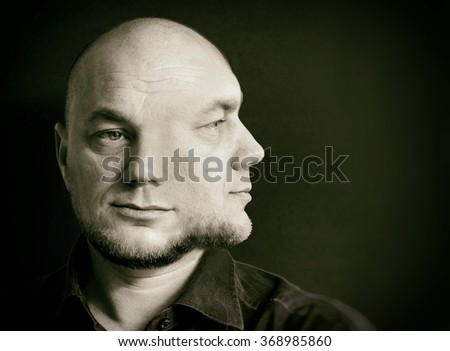 Two-faced person. Concept black and white photo.  - stock photo
