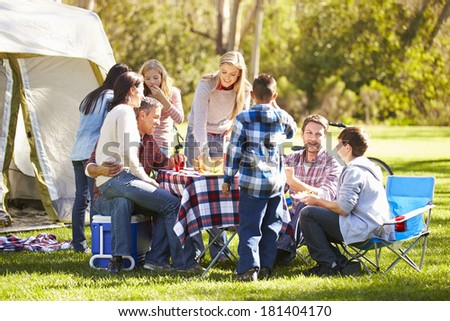 Two Families Enjoying Camping Holiday In Countryside - stock photo