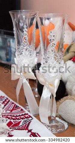 Two fancy wedding goblets glasses - stock photo