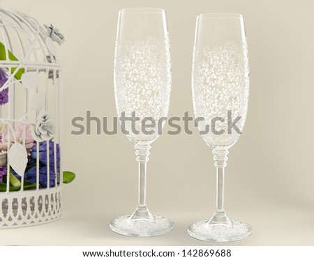Two fancy wedding goblets glasses on tender background - stock photo