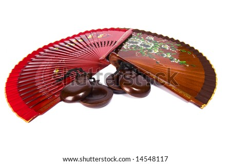 two fans and castanets on white background - stock photo