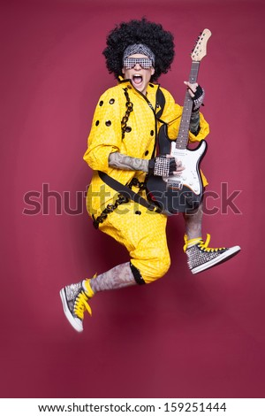 Two fantastic men in studio holding a guitar and microphone - stock photo