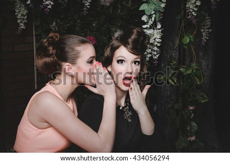 Two fashion girlfriends gossip. Beautiful caucasian young women with way hairstyle, red lips make up. Fashionable sexy couple of best friends girls, have a fun. Crazy emotions, creative photo concept. - stock photo