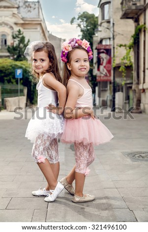 Two fashion little ballerinas on the street - stock photo