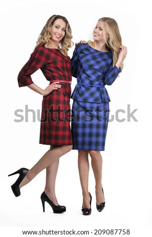 two fashion model girls in warm wool dress, blond and dark
