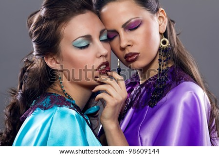 two fashion women with evening make up - stock photo