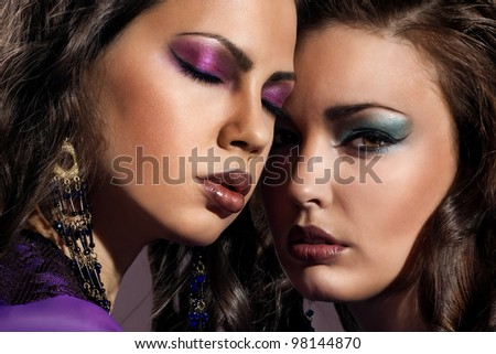 two fashion women with evening make up.close up portraits - stock photo